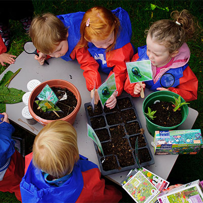 kids playing with soil and plants