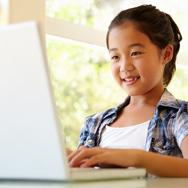 a Young Chinese girl working on her laptop