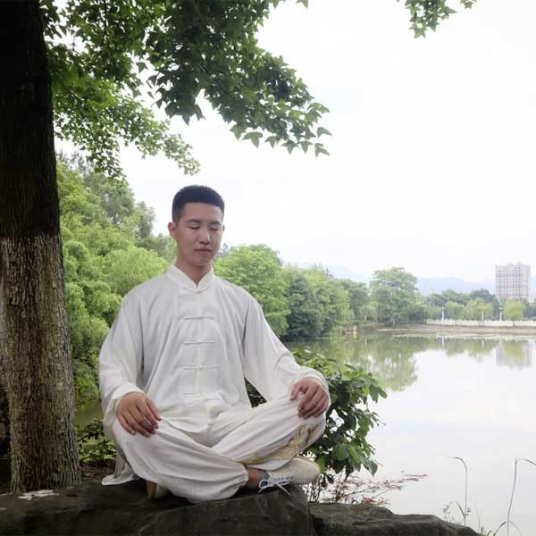 a Chinese man relaxing and easy-to-do Qigong exercise