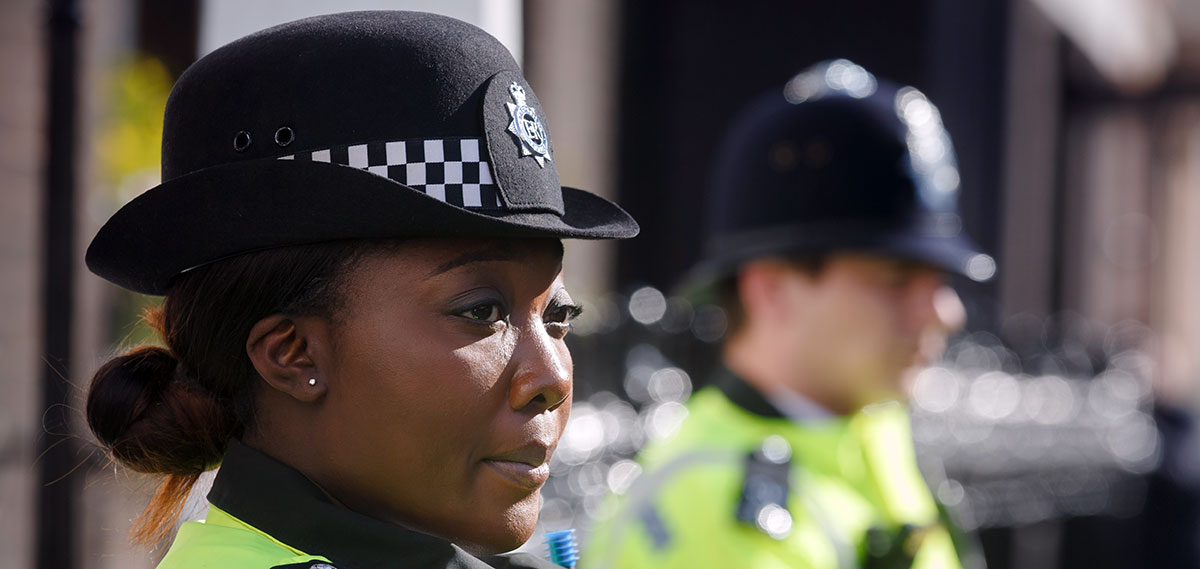 Female Police Officer with Male Officer in Background Blurred