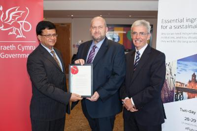 Peter (right) with the Minister of Natural Resources, Carl Sargeant and Nikhil Seth Director of UN Division for Sustainable Development. With the Act on the day it was sealed.