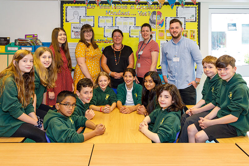 Picture of Student teachers on placement at Parkland Primary School in Swansea with class teacher and pupils
