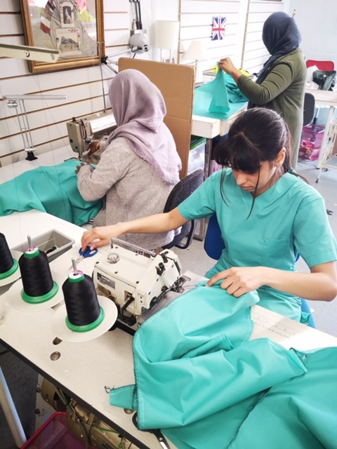 Jo Ashburner, a Surface Pattern Design graduate from University of Wales Trinity Saint David (UWTSD) and founder of Red Dragon Manufacturing Flagmakers, has launched a new campaign to fund the production and supply of scrubs for frontline workers in the NHS.