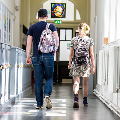 student walking in the corridor
